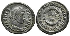 Ancient Coins - CRISPUS. Ae, Follis. 321-324 AD. Siscia mint, 1st officina. CAESARVM NOSTRORVM, VOT / X in two lines; all within laurel wreath; A SIS(sun).