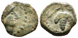 Ancient Coins - LIXUS. Mauretania. Ae. Circa 50-1 BC.  Head of Chusor-Ptah right, wearing headdress adorned with cord / Grape bunch on vine.