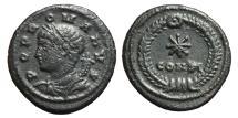 Ancient Coins - POPULUS ROMANUS (Constantine I). Ae, Follis. 330 AD. Constantinople mint. CONST and star in wreath. RARE.
