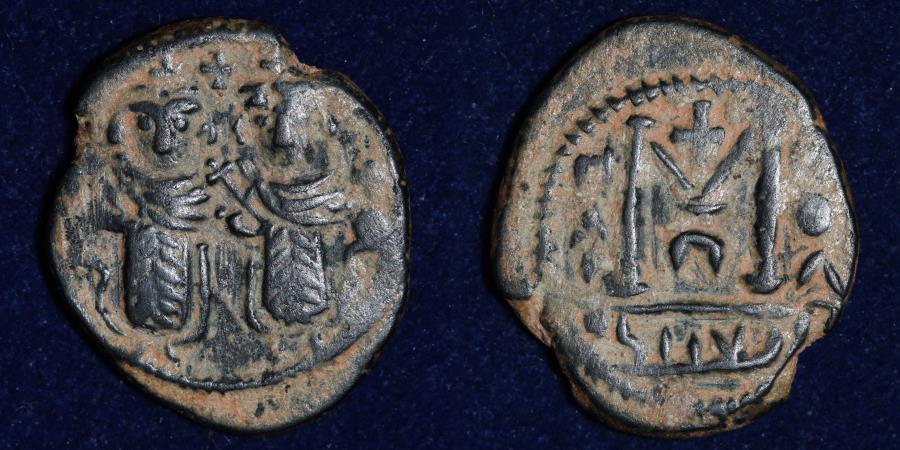 "World Coins - ARAB BYZANTINE ""Justin and Sophia"" type. Late 7th century AE fals, Ba'albakk mint (4.12g,21mm) ABOUT EF"