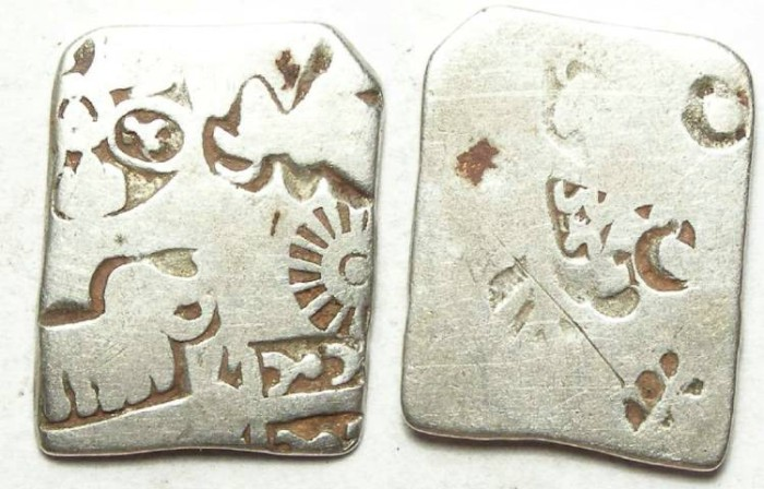 Ancient Coins - India, Mauryan Empire. Punch mark silver. 321 to 187 BC.  22 mm on it's longest dimension.
