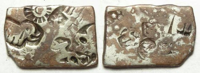 Ancient Coins - India, Mauryan Empire. Punch mark silver. 321 to 187 BC.  23 mm on it's longest dimension.