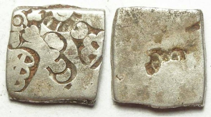 Ancient Coins - India, Mauryan Empire. Punch mark silver. 321 to 187 BC.  19.5 mm on it's longest dimension.