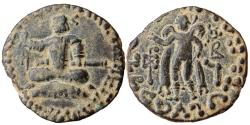 Ancient Coins - INDIA, INDO-SCYTHIANS:Azes, Circa 58-12 BC. AE (8.55gm). Azes seated on cushion, with legs crossed, raising hand and holding sword; ja in Kharosthi to left / Hermes standing left,
