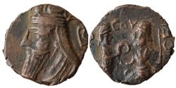 World Coins - PARTHIAN KINGDOM: Vologases VI, AD 208-228, AE Unit?, 4.62gm, bust left, wearing tiara, letter B to right // king seated on throne, receiving diadem,