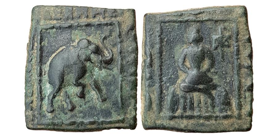 Ancient Coins - INDIA, INDO-SCYTHIANS: Maues, Circa 125-85 BC. AE (8.45gm). Elephant advancing right / Maues seated facing cross-legged on couch, holding sword in lap