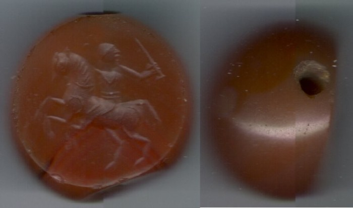 Ancient Coins - Ancient Near Eastern Art: Carnelian Scarab Seal Gem, A Parthian/ Sasanian horseman waving a sword,  made to be worn around the neck, red in color.