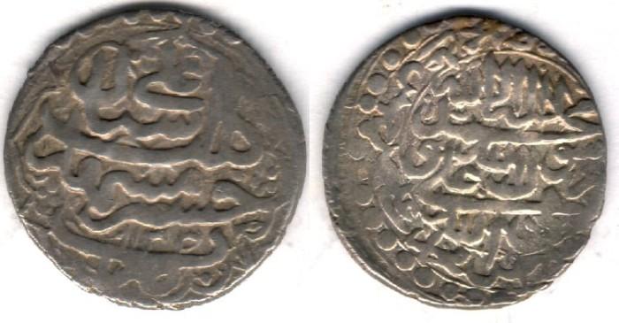 World Coins -        Item #32231 Safavid (Iranian Dynasty) Shah Sultan Hussein (AH 1105-1135) silver Abbasi, Mashhad mint (scarce), AH1133 (AD1720), Album #2686, KM #291a (type E) SCARCE type.