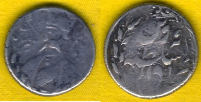 World Coins -   Item #35307 Qajar (Persian Dynasty) Nasir Din Shah (AH 1264-1313) ½ Kran, Qazvin ND (portrait type), KM #828, Album #2935 RARE MINT