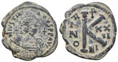 Ancient Coins - Justinian I. 527-565. Æ Half Follis 8.0 gr. 26.0 mm