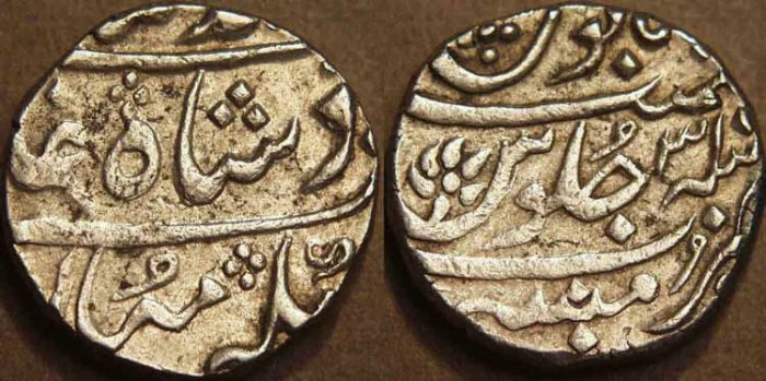 World Coins - BRITISH INDIA, BOMBAY PRESIDENCY: Silver rupee in the name of Muhammad Shah (1719-1748), Munbai, RY 31. SCARCE!
