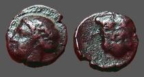 Ancient Coins - Ionia, Magnesia ad Maeandrum. AE8 Hd of Apollo / Breastplate Armor