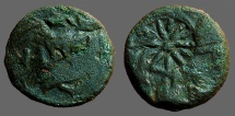 Thrace, Pantikapaion. AE20 Head of Pan left. / Roaring lion.  Countermark