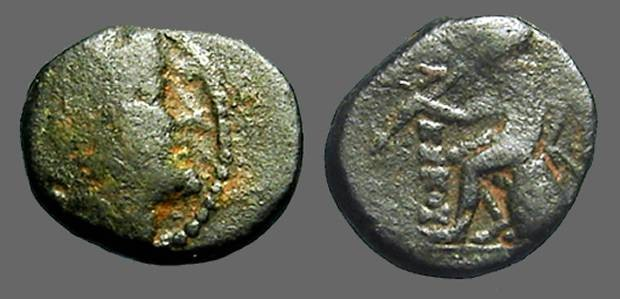 Ancient Coins - Antiochos III AE13 Apollo seated on omphalos, w. arrow