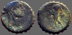 Ancient Coins - Seleukos IV AE18 Serrate.  Apollo / naked Apollo stg. w. arrow, tripod altar