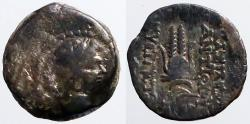 Ancient Coins - Antiochos VII AE17  Bust of Eros / Head dress of Isis
