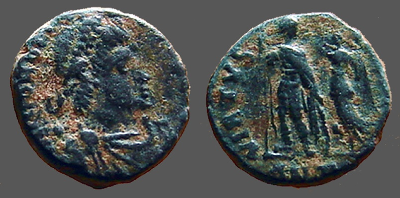 Ancient Coins - Honorius AE3 (14mm) Victory holds wreath over standing Honorius.  Antioch, Turkey