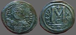 Ancient Coins - Justinian I AE35 Follis.  Facing bust.  Constantinople.  year 16