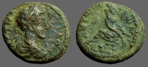 Ancient Coins - Commodus AE18 Decapolis, Gerasa.  Tyche on rocks, River god below