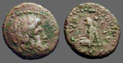 Ancient Coins - Antioch Syria AE18 Hd of Zeus / Apollo seated left