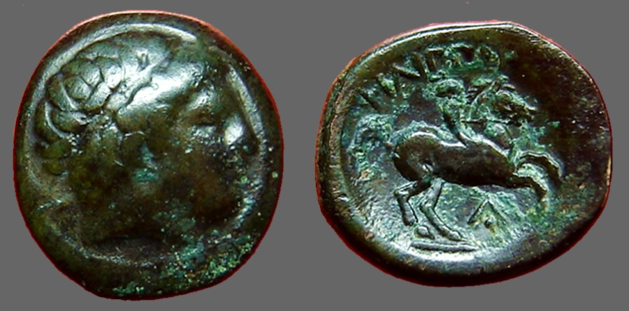 Ancient Coins - Philip II AE17 Hd of Apollo / young male horseback   head of Apollo right wearing taenia.