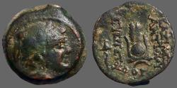 Ancient Coins - Seleukid.  Antiochos VII AE17  Bust of Eros / Head dress of Isis