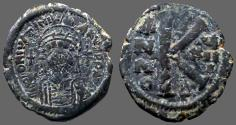 Ancient Coins - Justinian I AE26 1/2 Follis.  year 18.  Constantinople