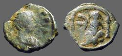 Ancient Coins - Justin I AE12 Pentanummium.  Tyche of Antioch in temple, River God below.