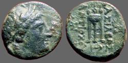 Ancient Coins - Seleukid. Antiochos II AE16 Apollo / Tripod Altar