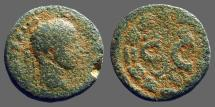 Ancient Coins - Caracalla AE18 Antioch on Orontes SC within wreath. Δε above, Eagle below