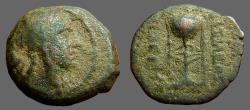 Ancient Coins - Antiochos II Theos.AE17 Apollo / Tripod Altar, anchor.