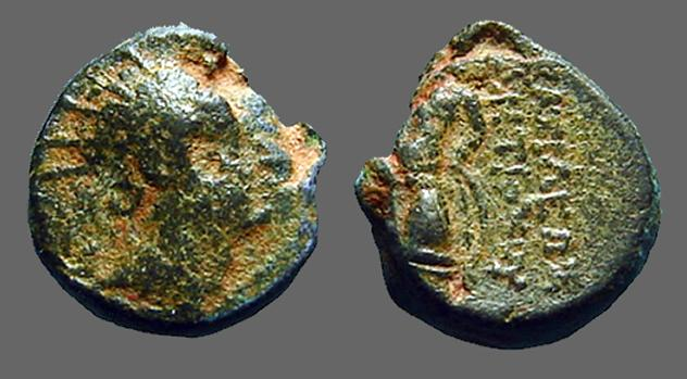 Ancient Coins - Seleucus III AE14 Hd of Apollo / Apollo seated left on omphalos, holds arrow and bow.