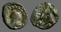 World Coins - Kushan Vashishka AE19 Unit Pushkalavati.  Kushan King stg / Ardhoksho seated