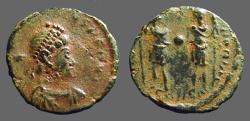 Ancient Coins - Honorius AE4.  Honorius & Theodosius II hold globe between them