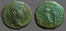 Ancient Coins - Commodus AE27 Sestertius.  Apollo standing left, holding Lyre on column