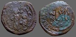 Ancient Coins - Heraclius & Heraclius Constantine AE30 Folliis overstruck on Maurice Tiberius facing bust follis