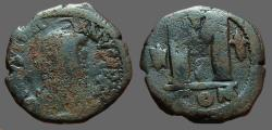 Ancient Coins - Justinian I AE27 Follis.2 star, 1 cross. Constantinople