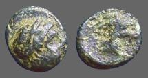 Ancient Coins - Aiolis, Aigai, AE11 Laureate head of Apollo / Head of goat right.   3rd Cent. BC.