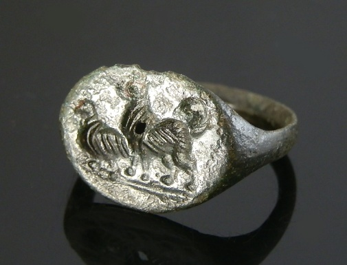 Ancient Coins - GREEK BRONZE RING DEPICTING DOG AND BIRD