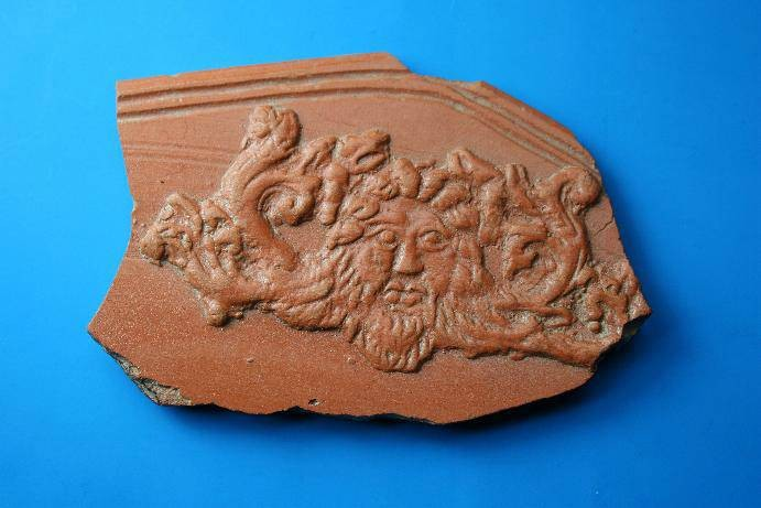 Ancient Coins - Nice Roman redware pottery sherd depicting the bust of Neptune.  C. 3rd-4th century AD.