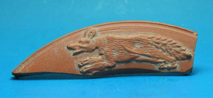 Ancient Coins - Late Roman red ware sherd decorated with a running fox/wolf.  C. 4th-5th century AD.