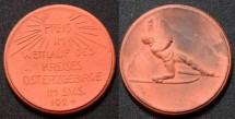 World Coins - German gipsform orange brown porcelain medal - skiing