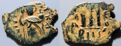 Ancient Coins - Arab Byzantine bronze, odd shape - Umayyad Caliphate, AE fals