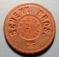 Us Coins - Schenk Brothers 2 1/2 cents trade token - red fiber