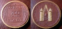 World Coins - German gold gilded brown porcelain medal - Lobau, 700 years