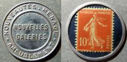 World Coins - French encased postage, 10 centimes - Nouvelles Galeries