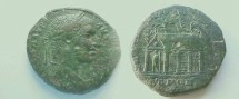Ancient Coins - Elagabalus AE26 of Nikopolis.  Perspective view of shrine with two columns in front, four columns on the side, forest in background, figure of Serapis (?) within, holding scepter.