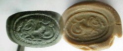 Ancient Coins -  Roman bronze seal ring with intaglio of a hippocamp.  Size 5.