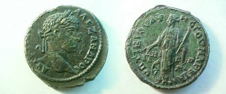 Ancient Coins - Severus Alexander AE26 of Markianopolis.  Nemesis standing left with scales and rod, wheel at foot.