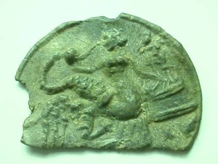 Ancient Coins -  Roman bronze applique with design of Leda and the Swan.  32mm.